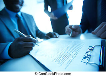 Signing contract - Image of businessman signing contract...