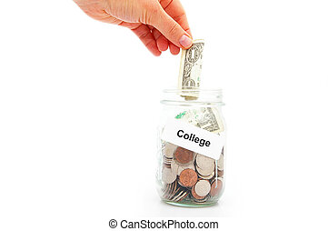 saving money for college - hand putting a dollar into a...