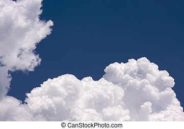 Puffy Clouds on a blue sky.