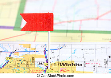 Wichita, Kansas Red flag pin on an old map showing travel...