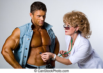 Female doctor checks a patient
