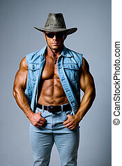 Muscular man in a cowboy hat