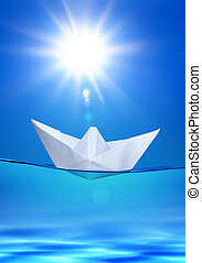 paper toy-ship under sun - white paper toy-ship on the blue...