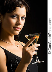 Celebrating - Portrait of charming woman holding glass of...