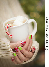 Woman with Red and Green Nail Polish Holding Cup of - Woman...