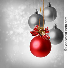Christmas red ornaments over silver lights background