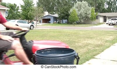 Dumping Grass from Lawn Tractor - Guy stops red lawn tractor...
