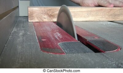 Circular Saw Cutting Two by Four - Circular table saw cuts...
