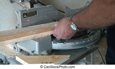 Cutting Wood - Tape Measuring - Man is cutting wood with...