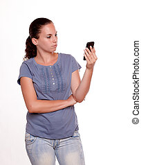 Charming young woman reading on cellphone screen - Charming...