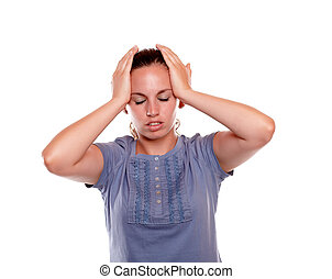 Young woman with headache holding her forehead