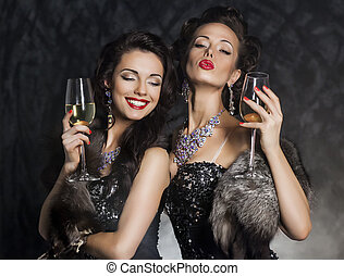 New Years Eve of two beautiful young women with wine glasses...