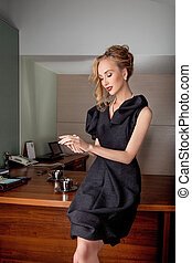 Thoughtful business woman fashion model in modern office indoors