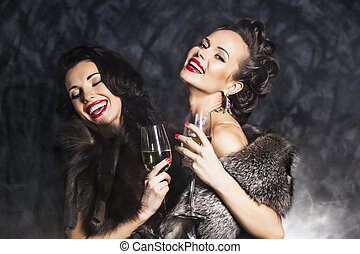Joy. Elation. Rich woman laughing with crystal of champagne...