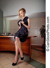 Attractive businesswoman fashion model at secretary desk -...