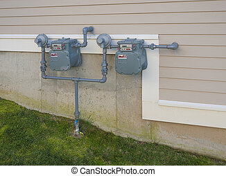 Gas meters on outside wall of a residential house