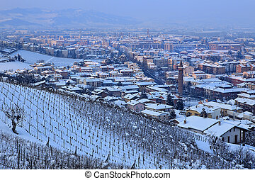 Town of Alba at evening. Piedmont, Italy.