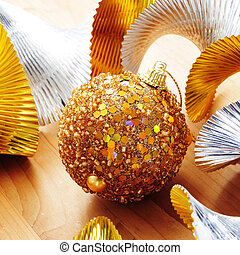 golden christmas ball and golden and silver garland - a...