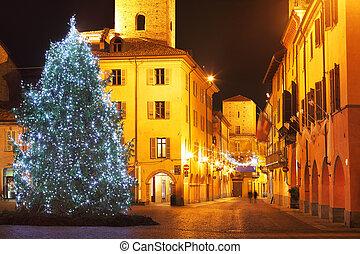 Christmas tree on central plaza Alba, Italy - Illuminated...
