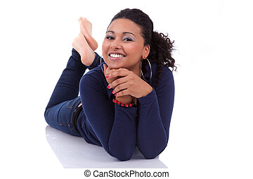 Young African American woman lying down on the floor