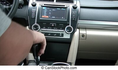 Driving Car and Using Touch Screen Radio - Clip shot from...