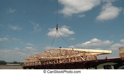 Crane Lifts Wood Framing Into Air - Crane cable lifts an...