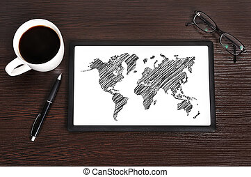 map on touchpad - Workplace with world map on touchpad