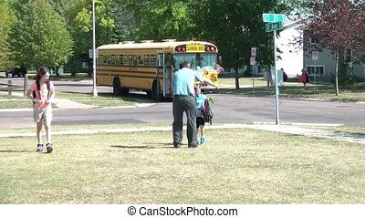 Dad Meets Kids Off Bus After School - Dad in business attire...