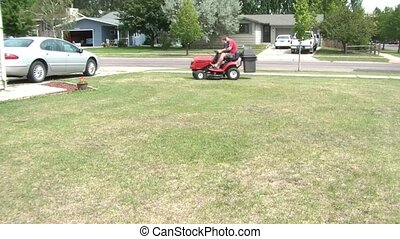Father and Son on Riding Lawnmower Together - Father and son...