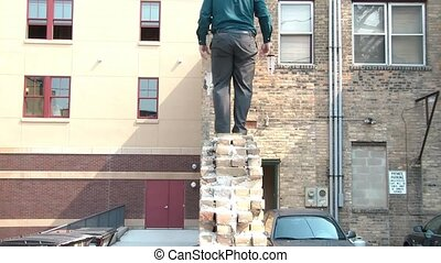 Businessman Walks Narrow Wall in Air - Businessman walks...