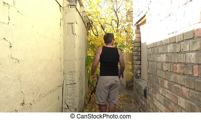 Frustrated Man Beats Wall - Severely frustrated man kicks,...