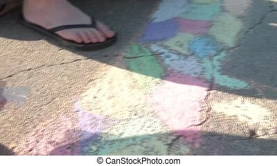 Girl Uses Colored Chalk on Concrete - Girl uses colored...