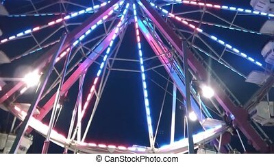 Ferris Wheel Pan Up with Lights - Slow pan up of colorful...
