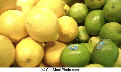 Citrus Fruits Produce Pan - Panning of lemons, limes, and...