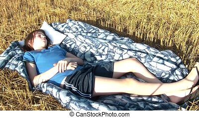 Girl Wakes Up in Hay Field