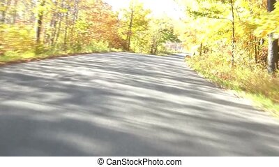 Fall Drive Down Winding Road - Car drives down winding road...