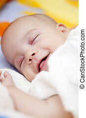 Sleeping Baby Smiling - Sleeping Baby is smiling in the bed