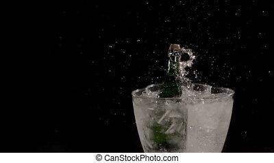 champagne - bottle falling in ice bucket