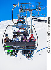 Skiers on a ski-lift of Zell am Ziller, Tirol, Austria...