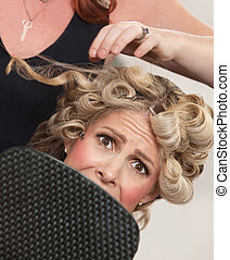 Frightened in Hair Salon - Frightened blond white female...