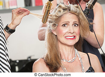 Anxious Woman with Hair Stylists - Anxious middle aged white...