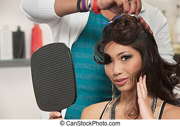 Woman Watching Hair Stylist Work - Sexy woman feeling hair...