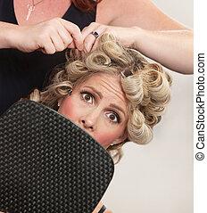 Nervous Customer in Hair Salon - Nervous female holding...