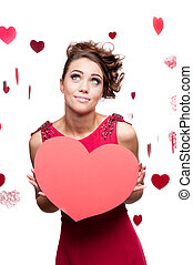 young cheerful woman holding red paper heart - young...