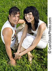 a young couple in the park