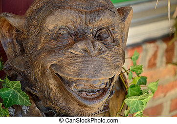 Monkey grins - A wooden monkey offers outdoor decor and good...