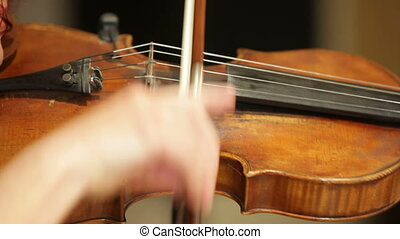 Classical music - Young woman playing classical compositions...