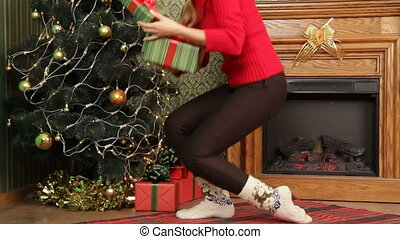 Hiding gifts for Christmas - Mother hiding gifts for...