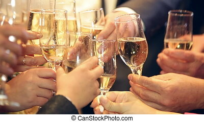 Raising glasses for a toast - Guests raising glasses for a...