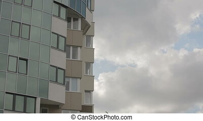 Skyscraper on a cloudy day - View of a skyscraper on a...